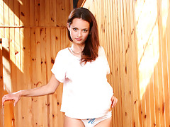 Busty Vally struts her long legs and petite body before rubbing down her pussy with her fingersvideo