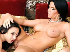 Dark haired MILF shows this young girl how to eat good pussyvideo